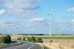 Wind generator turbine on summer landscape Royalty Free Stock Photo