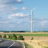 Wind generator turbine on summer landscape Stock Photography