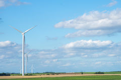 Wind generator turbine on summer landscape Stock Images