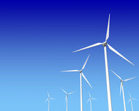 Wind Generator Turbines over Blue Sky. Green Renewable Energy Royalty Free Stock Images