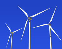 Wind Generator Turbines over Blue Sky. Green Renewable Energy Stock Photo