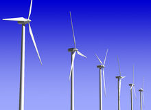 Wind Generator Turbines over Blue Sky. Green Renewable Energy Royalty Free Stock Photo