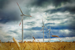 Wind Generator Turbines over cloud sky - Green Renewable Energy Stock Photo