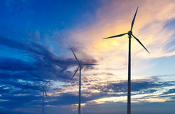 Wind generator turbines sihouettes on sunset Royalty Free Stock Photo