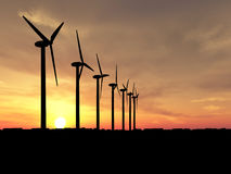 Wind generators. Wind turbines over orange sunrise ( see more in my portfolio royalty free stock photos