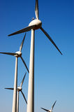 WIND generators. Eolic power generator: wind generators over blue sky Royalty Free Stock Image