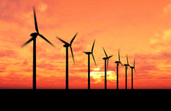 Wind generators. Wind turbine farm over sunset royalty free stock photography