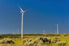 Wind Generators against a blue sky Stock Image