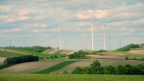 Distant wind turbines and fields in Austria Stock Image