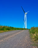 Wind Generators along a dirt road Stock Images