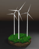 Wind generators on clod of earth Royalty Free Stock Photos
