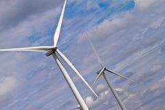 Wind generators and clouds Royalty Free Stock Photo