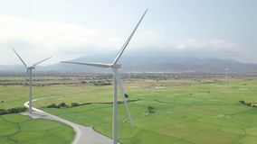 Wind generators on green field aerial landscape. Drone view wind energy station. Alternative natural source and ecology. Conservation. Clean and renewable stock video footage