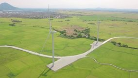 Wind generators on green field on mountain landscape. Aerial view windmill turbine on wind energy station. Renewable. Sustainable, generation alternative stock footage