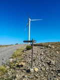 Wind generators on the mountain with blue sky stock photo