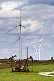 Wind generators and oil wells Royalty Free Stock Photos