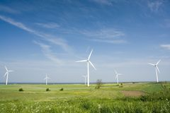 Wind generators in open field. A view of an open field of wind powered electrical generators Stock Images