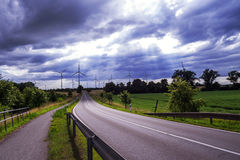 Wind generators and a road Stock Image
