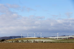 Wind generators in rural landscape in winter Stock Photos