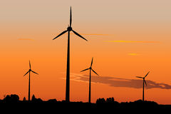 Wind generators in sunrise Stock Photo
