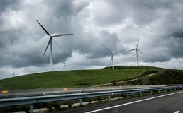 Wind Generators Turbines are generating electricity next to high Stock Photography