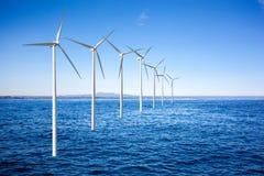 Wind generators turbines in sea. Wind generators turbines in the sea Royalty Free Stock Photo