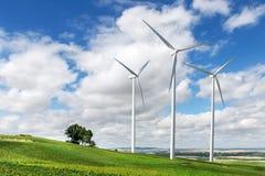 Wind generators turbines on summer landscape Stock Photos