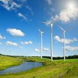 Wind generators turbines on summer landscape Royalty Free Stock Photos