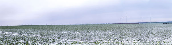 Wind generators in winter landscape Stock Photos