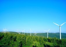 Wind driven generators on the top of mountain with blue sky. Lots of wind driven generators on the top of mountain with blue sky, Iceberg beam in Hebei Province stock image
