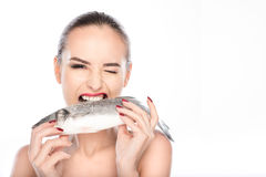 Wind girl eating seafood with appetite Royalty Free Stock Photo