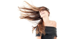 Wind and Hair. Beautiful woman in studio shot with wind on hair Royalty Free Stock Photo