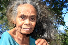 Indonesian old woman with grey hair from Timor stock photo