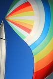 The wind has filled colorful spinnaker sail Royalty Free Stock Photography