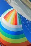 The wind has filled colorful spinnaker sail Stock Photo