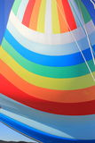 The wind has filled colorful spinnaker sail Stock Image
