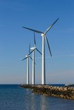 Wind has power. Three wind turbines and the sea Stock Photography