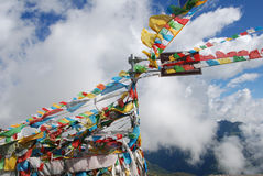 Wind-horse flag in Tibet. Wind-horse flags   flying  on  the  road  is a common   scene in  Tibet Royalty Free Stock Photos
