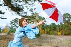 Wind, hurricane - gir with umbrella Stock Photography