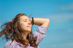 Wind inflates hair of the woman with closed eyes Stock Images