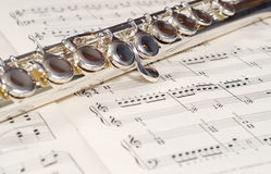 Wind Instrument. Closeup view of a metal wind instrument shot on a music sheet Stock Images