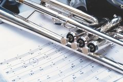 Wind instrument trumpet and notes. Selective focus Stock Photo