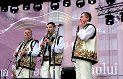 Wind instruments performers have fun playing music in the Moldovan national costumes Royalty Free Stock Photo