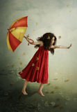 The wind. The little girl with umbrella in hand, autumn leaves, wind Stock Photography