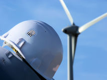 Wind  mil and helmet. Wind mil and helmet in a blue sky Stock Photo