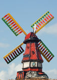 Wind mill. Ceramic toy wind mill with colored blades Stock Photo