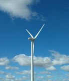 Wind mill. Against a blue sky and clouds Stock Photo