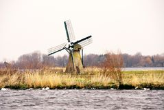 Wind mill. A wind mill at an isle in a lake Stock Image