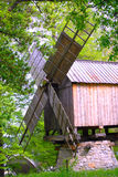 Wind mill. Old wooden wind mill in Dimitrie Gusti Bucharest Village Museum. The wind mill is from the 19th century and was brought from Valea Nucarilor, Tulcea Stock Photo