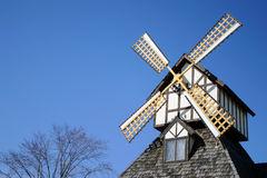 Wind mill. A descorative wind mill on top of this building Royalty Free Stock Image